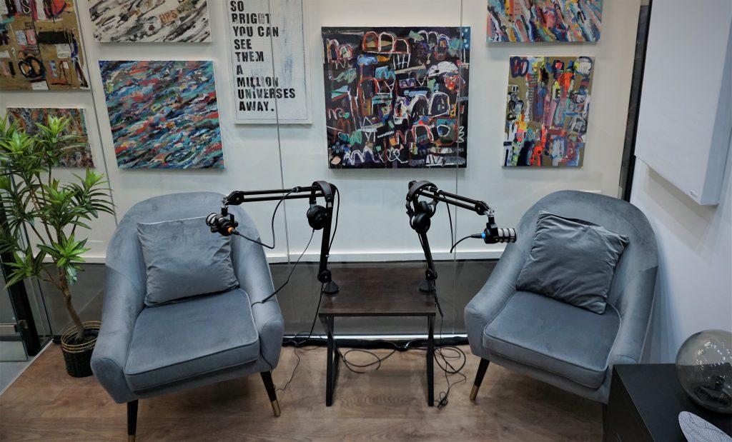 Shoreditch Podcast Studio with art backdrop